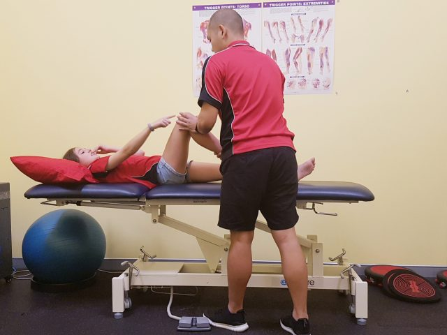 One of our great physios helps a girl with a sore knee
